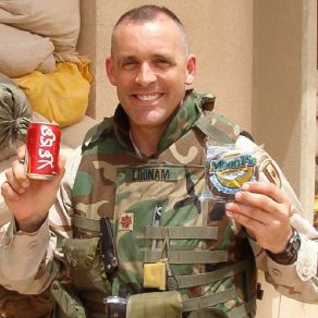 Major Tim Loonam, DVM, enjoys a snack break while deployed to Iraq.